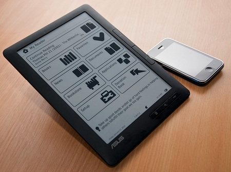 Asus DR-950 e-book reader next to iphone