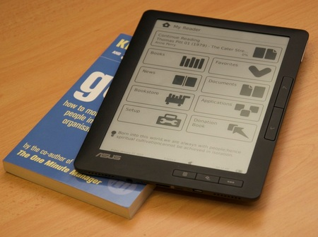 Asus DR-900 e-Book Reader with real book