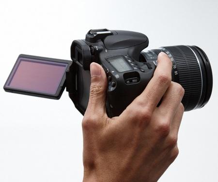 Canon EOS 60D Digital SLR Camera on hand
