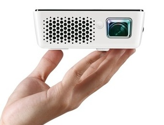 BenQ Joybee GP2 Mini Projector with iPhone iPod Dock on hand