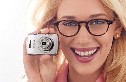 Nikon CoolPix S01 Ultra-compact Digital Camera on hand