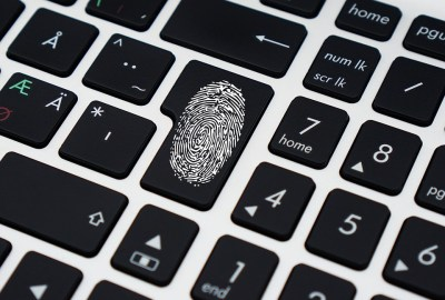 User identity authenticaion symbolized by fingerprint on keyboard.