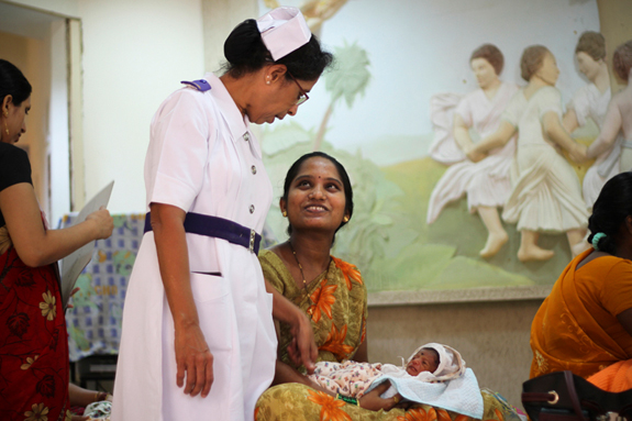 """MUMBAI - OCTOBER 4: Nurse Rekha Samant Counseling Mothers on Kangaroo Mother Care at the Follow Up Clinic, Kangaroo Mother Care Centre, at Seth GS Medical College & KEM Hospital on October 4, 2010 in Mumbai, India. (Photo by Ritam Banerjee/Getty Images for Save the Children)  released  The first International Neonatal Nursing Excellence Award recognizes the commitment of nurses working on the frontlines of newborn care in resource-challenged countries, where the majority of newborn deaths occur. Regina Obeng from Kumasi in Ghana and Rekha Kashinath Samant from Mumbai, India, were selected from nominations sent from all over the world. They received their awards during the opening ceremony of 7th International Conference of the Neonatal Nurses at the Inkosi Albert Luthuli International Convention Centre in Durban, South Africa. The award is organized by the International Conference of Neonatal Nurses (ICNN) in conjunction with Save the Children, the Council of Neonatal Nurses (COINN) and the Neonatal Nurses Association of Southern Africa (NNASA). In India, more than one million babies die in their first month of life. Rekha Samant is a senior staff nurse in the Neonatal Intensive Care Unit at King Edward Medical Hospital and Seth Gordhandas Sunderdas Medical College in the megacity of Mumbai. With 15 years experience as a senior staff nurse she is also one of a rare breed of nurses: she has a one-year diploma in neonatal nursing, which she obtained at SNDT University in Mumbai. Samant is a national trainer in Kangaroo Mother Care (KMC) and the KMC Unit at her hospital is internationally recognised as a centre of excellence. """"Rekha is an intelligent, sincere, passionate and extremely dependable nurse who has excellent acumen in the management of newborn babies,"""" said a colleague, who nominated her for the award. """"She deserves the lion's share of the credit for successfully addressing the needs of newborns in the hospital's neonatal unit."""" De"""