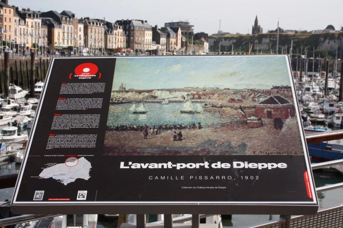 Panel showing one of Camille Pissarro paintings of Dieppe Port, Normandy