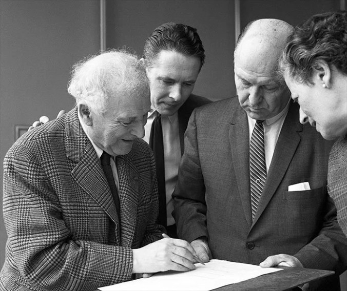 Marc Chagall sketches out the initial design of the window with members of the UN Memorial Committee. UN Photo