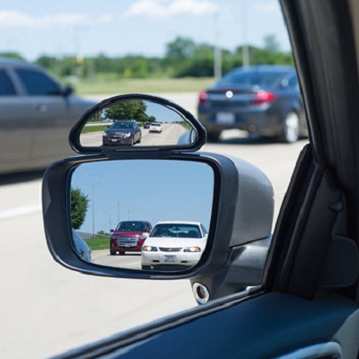 The Blind Spot Eliminator - A side view mirror that expands a driver's field of vision 2 1/2X to easily see a car's blind spots