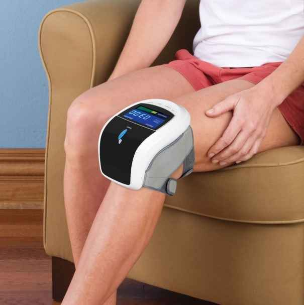 The Triple Therapy Knee Pain Reliever - A hands-free device that combines LED light treatment with vibration and compression massage to ease pain and stiffness in the knee