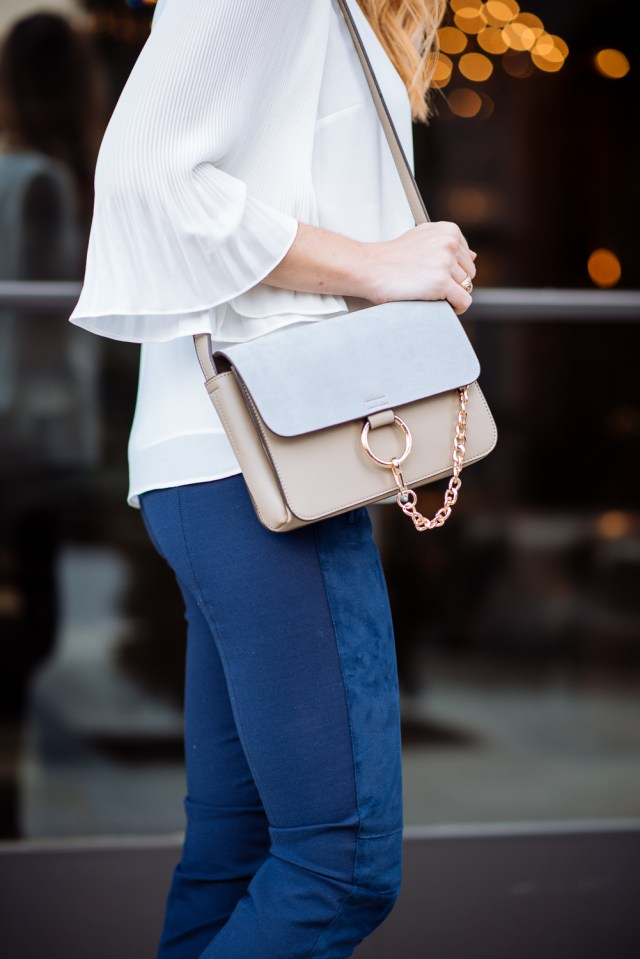 Fashionable work wear for women featuring shades of Suede: Suede leggings + pleated top + suede booties