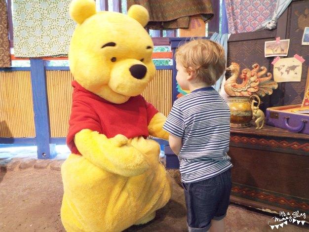 Boy meeting Winnie the Pooh at Disney World