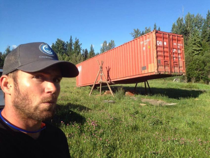 Eben with the lifted shipping container, up on log tripods