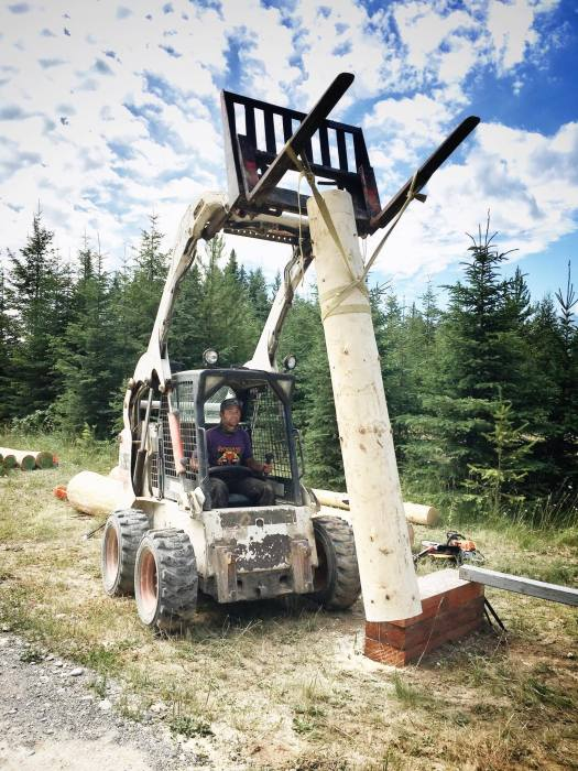 Lifting our log column with the bobcat forks
