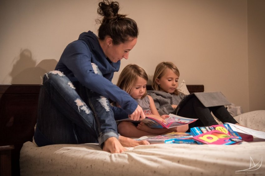 homeschooling the girls, in bed
