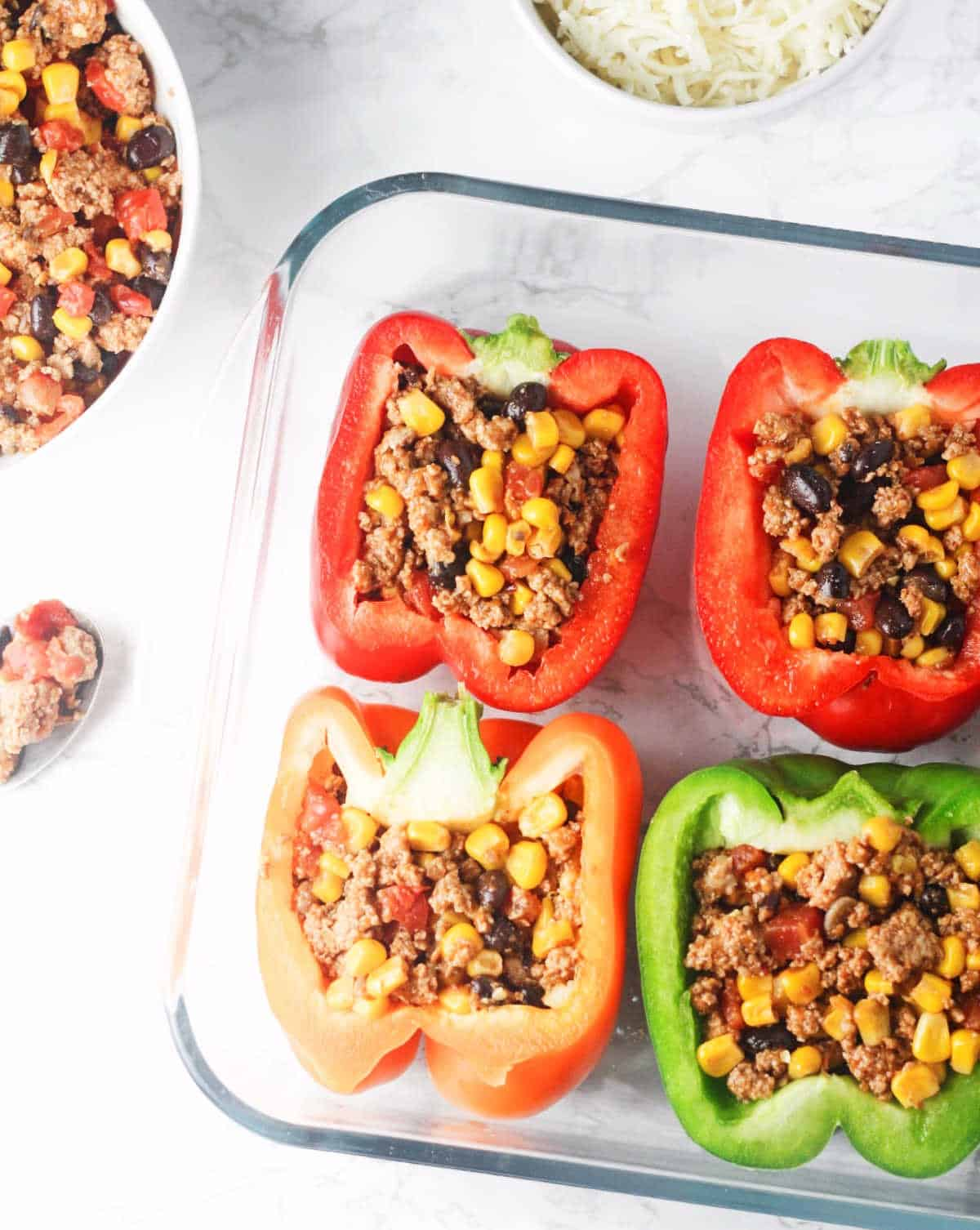 Chipotle Turkey Stuffed Peppers - Deliciously protein packed bell peppers, stuffed with lean ground turkey, black beans, corn and topped with a chipotle drizzle. Low carb, gluten free and delicious! www.itscheatdayeveryday.com
