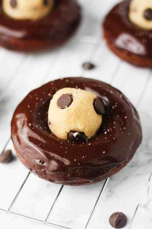 Kick start your morning with these super easy, Gluten Free Chocolate Cookie Dough Donuts. They're low carb, low calorie and high in protein! www.itscheatdayeveryday.com