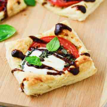 Be sure to entertain your guests with these super simple, 5 ingredient Balsamic Caprese Mini Tarts! Made with Pepperidge Farm Puff Pastry. www.itscheatdayeveryday.com