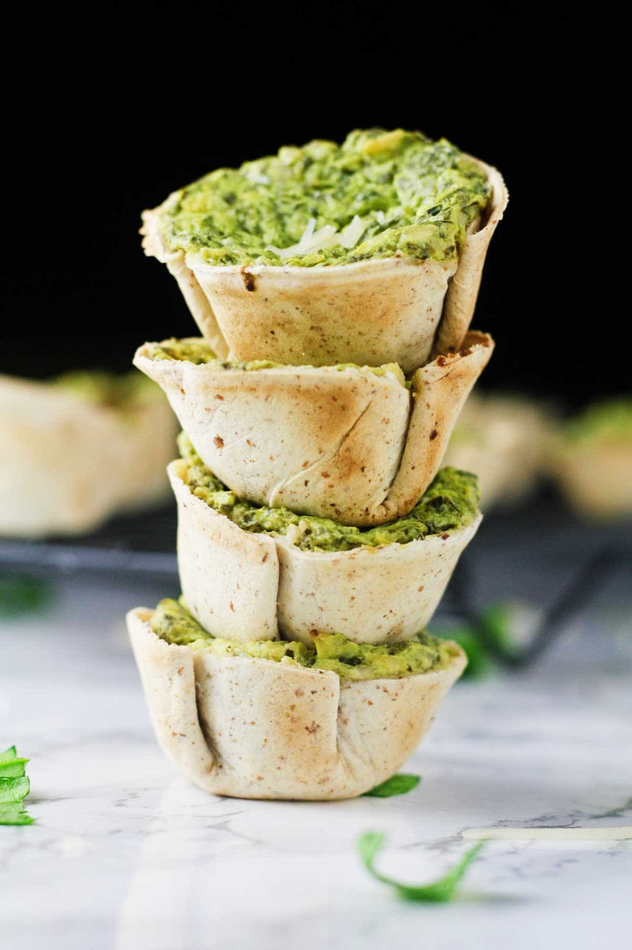 Low Carb Spinach Artichoke Dip Bites. Made with Xtreme Wellness wraps. A super easy, guilt-free crowd pleaser! www.itscheatdayeveryday.com