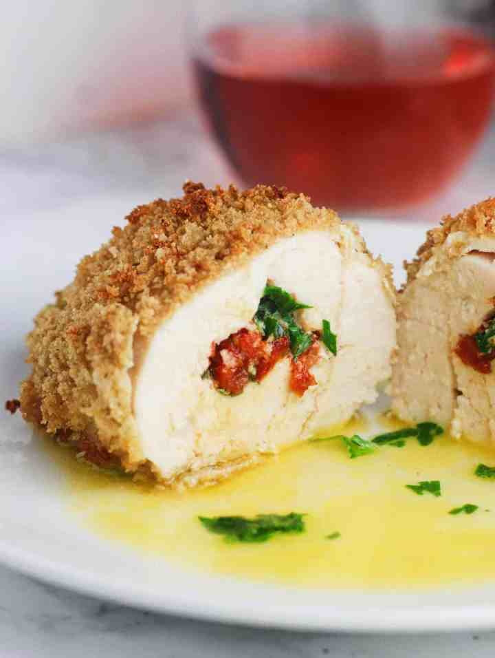 Sun Dried Tomato and Garlic Stuffed Chicken - chicken breast halves, stuffed with garlic butter and sundried tomatoes then coated in panko breadcrumbs and baked. Deliciously fancy! www.itscheatdayeveryday.com