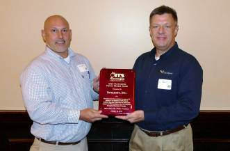 Mark Demidovich (L), presents Mike Clance of Intelight with the 2016 ITS Georgia Best of ITS Outstanding Private Sector Member Award