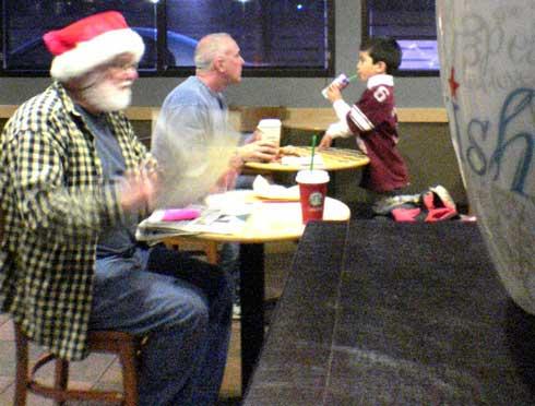 Santa Drinking Starbucks