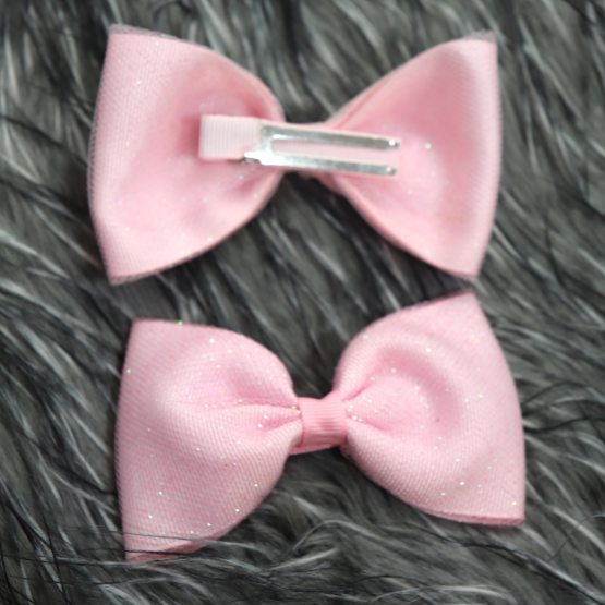 pink glittery bow front and back