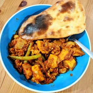 the spicy bean - a cooked naan bread with a vegetarian curry
