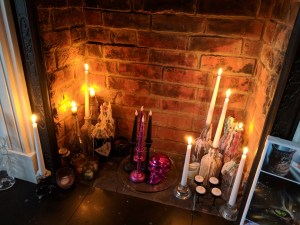 the spicy bean - stick candles in an empty fireplace