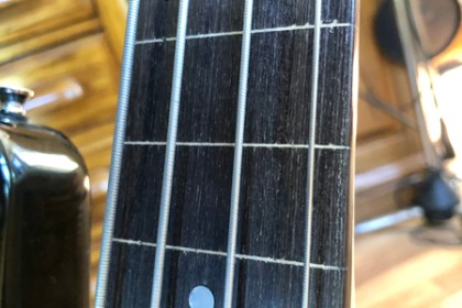Like Jaco, we pulled the frets and finished the fretless board ourselves. No epoxy here! Lemon oil and D'Addario Chromes.