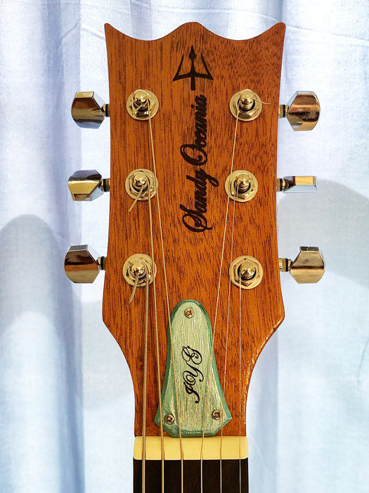 Sandy's hand-painted, laser engraved truss rod cover ties everything together!