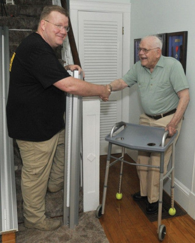 Brother Mike Walsh with WW2 Veteran Walter Gilbert, who received a stairlift through A Lift For A Vet