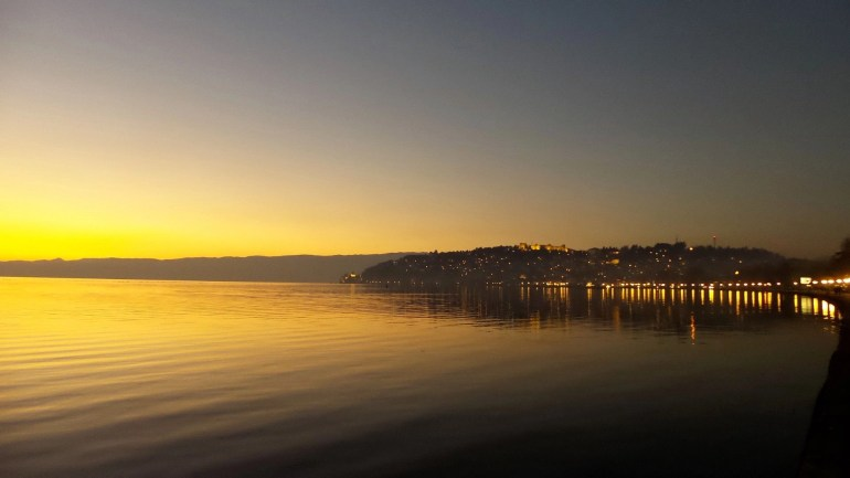 Watching the sun go down. watching the sunset over the city Ohrid. Beautiful sunset photos. Amazing sunset photos.
