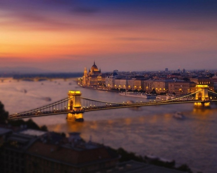 View of the Parliament building of Hungary in Budapest and the Margret Bridge at sunset.