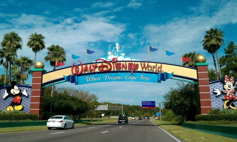 Going on a family trip to Orlando, Florida and getting to the entrance to the Walt Disney World Resort with images of Mickey Mouse on both sides of the gate.