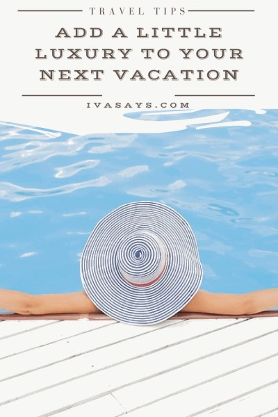 Luxury Lifestyle Travel Tips: A woman resting by the pool with her hands on a white wooden deck and wearing a blue stripped canvas hat enjoying her vacation.