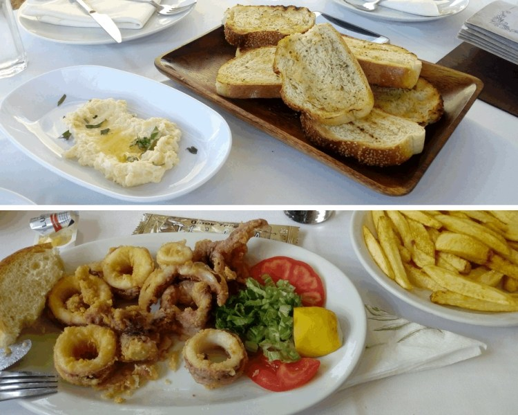 Several Greek seafood cuisine dishes of fried calamari, french fries, toasted bread with garlic spread.