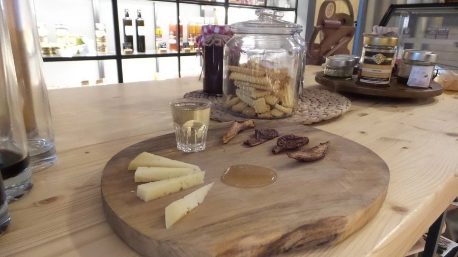"""Serving of cheese, dried pear, and honey with a shot of pear brandy on the Ljubljana food tour """"A tale of the river"""" by Bitemojo."""