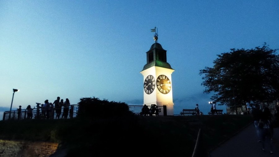 People around the The Clock Tower in Petrovaradin Fortress in Novi Sad.