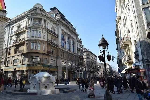 Buildings and people walking in Belgrade.