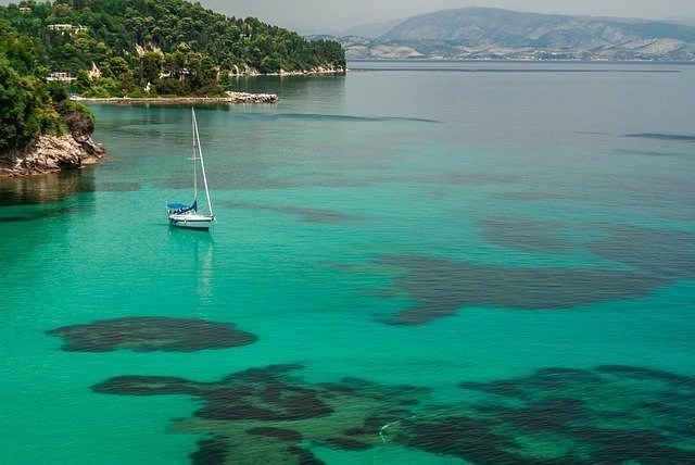 One of the best places to travel to in September is Corfu, Greece - offering clear sea and sandy beaches.