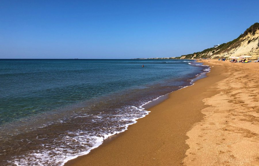 Sea and golden red sand at Marathias Beach in Corfu.