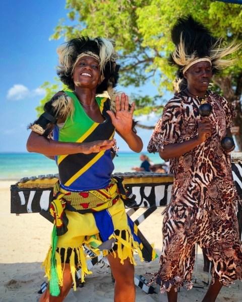 Woman and a man doing a traditional dance in Zanzibar, Tanzania.