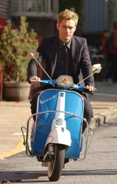 Jude Law on the set of ALFIE riding vespa motor scooter