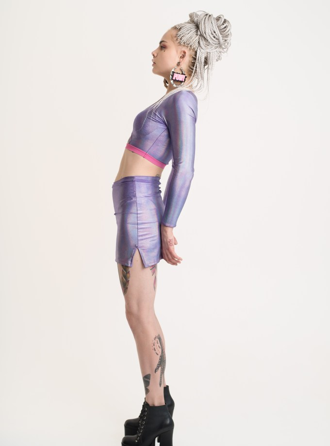 A purple holo skort made from the shiniest fabric. It has a cheeky short cut and built-in panties.