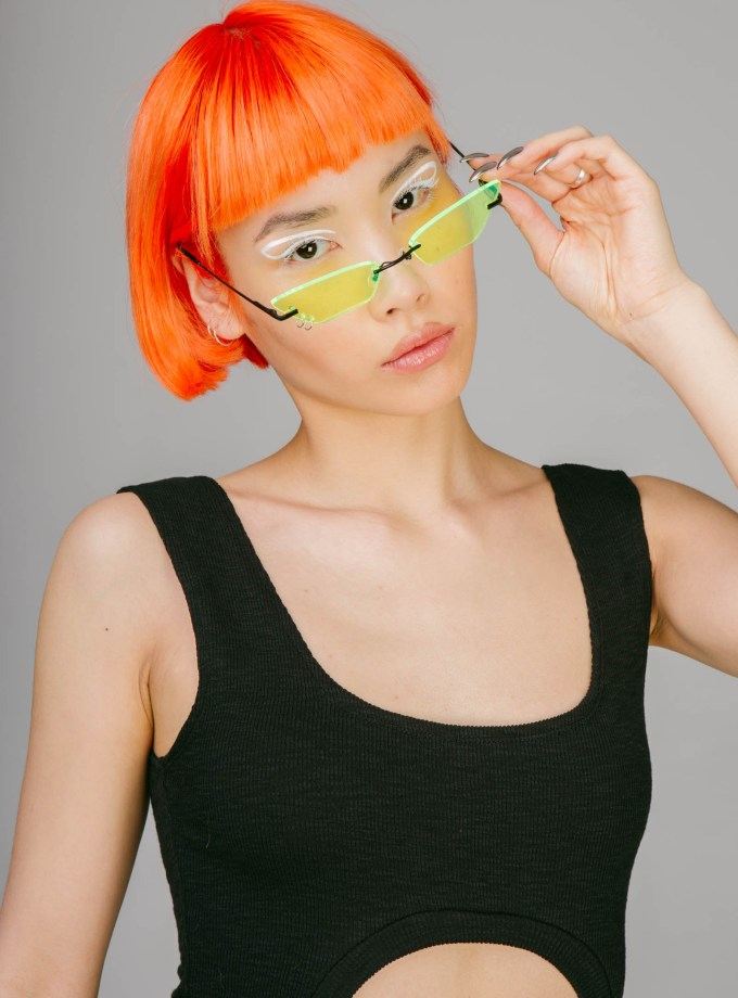 yellow sunglasses with piercing hoops