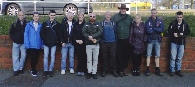 Our motley crew lined up outise the pub taken by Commando