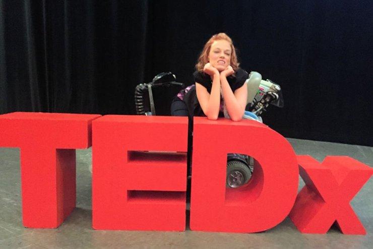 Josie posing behind a Gaint TEDx sculpture