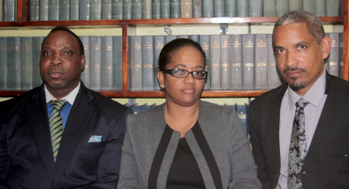 Senator Vynnette Frederick, centre, with lawyers Keith Scotland, left, and Andrew Pilgrim after her release on Thursday, July 11, 2013. (IWN photo)