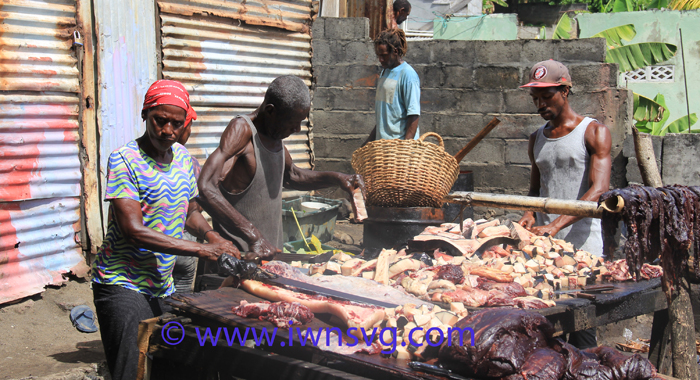 Persons involved in various activities surrounding the processing of whale meat and oil on Sunday. (IWN photo)
