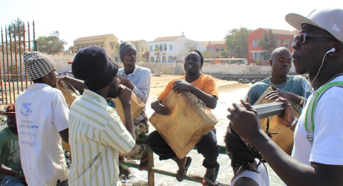 Musicians beat drums and play other traditional instruments to welcome visitors to Gorée Island. (IWN photo)