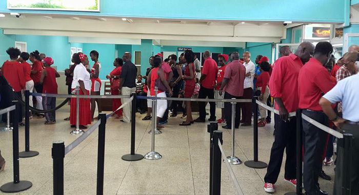 ULP failthfuls queue up to check in last December for the 10-minute flight from Arnos Vale to Argyle that formed part of the ULP's campaign strategy. Almost a year later, the airport remains incomplete.