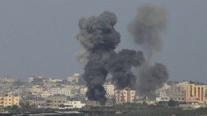 Smoke rises after an explosion in the northern Gaza Strip